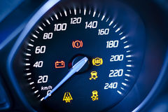 Fragment of instrument panel of car speedometer, tachometer. Photo presents car's, vehicle's speedometer or tachometer with visible information display Royalty Free Stock Images