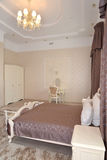 Fragment of an interior of a bedroom of a double hotel room. Luxury in light tones. Modern classics Stock Photo