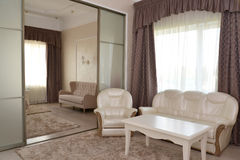 Fragment of an interior of a bedroom and drawing room of a doubl Royalty Free Stock Image