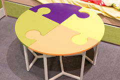 Fragment  interior children's room with a table in  form of  puzzle Stock Photo