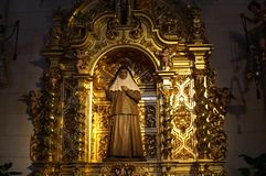 Fragment of the interior of the Christian Catholic Cathedral. Catholic Church. Gold salary. Christian temple. Rich interior Stock Photos