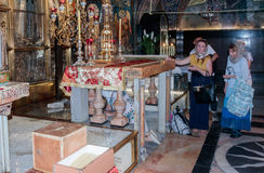 Fragment of the interior of the Church of the Holy Sepulchre in Jerusalem, Israel. Believers stand in line to touch Golgotha. Royalty Free Stock Photos