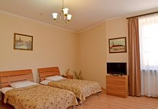 A fragment of an interior of the double hotel room with pictures on walls. Modern classics.  stock photo