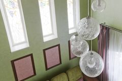 Fragment of the interior with a green sofa and picture cards stock photos