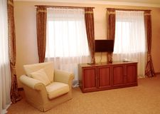 Fragment of an interior of the hotel room in brown tones. Modern classics.  royalty free stock photos