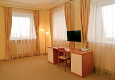 Fragment of an interior of the hotel room with a desk and a floor lamp. Modern classics.  royalty free stock photos