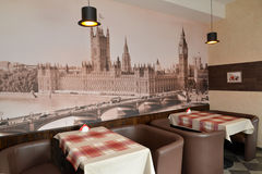 Fragment of an interior of modern cafe with the photo of the Westminster palace on a wall Royalty Free Stock Photo