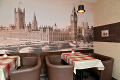 Fragment of an interior of modern cafe with the photo of the Westminster palace on a wall Stock Photo