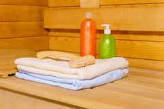 Interior of a modern Russian banya. Fragment of the interior of a small modern Russian banya with some bath accessories stock photography