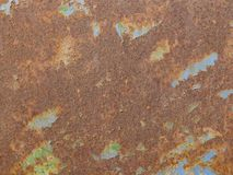 Rusty iron surface with peeling paint stock photo