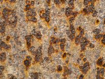 Scenic iron wall coated with corrosion. Daylight. Fragment of an iron wall covered with corrosion royalty free stock photos