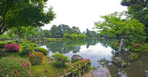 Fragment of japanese garden with stone lantern and big mossy roc Stock Images