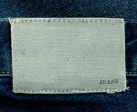 Fragment of jeans with pure label for your text. Stock Photography