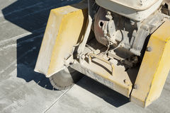 Fragment of a joint cutter machine on a brushed concrete surface Royalty Free Stock Images