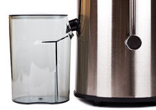 Fragment of juice extractor with a container Stock Photography