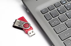 Fragment of the keypad of the modern notebook and usb flash driv Royalty Free Stock Images