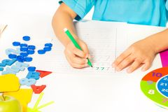 Fragment of kids hands holding mark pen  writing Stock Photos