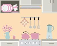 Fragment of a kitchen interior in pink color. Still life. There is a kettle and pan on the stove, also blender, a vase with flowers and other objects in the Stock Images