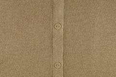 Pleat with buttons. Fragment of a knitted garment stock photography