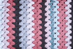 Fragment of knitted panel royalty free stock photo