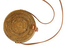 Fragment of ladies` wicker bag with a brown strap isolated on white. Background stock image