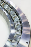 Fragment of a large roller bearing. Abstract industrial background Royalty Free Stock Photo