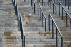 Fragment of a large staircase made of granite blocks with metal railings. Fragment of a large staircase made  of granite blocks with metal railings royalty free stock photos