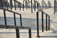 Fragment of a large staircase made of granite blocks with metal railings. Fragment of a large staircase made  of granite blocks with metal railings stock images