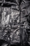 Fragment of leather jacket Stock Images