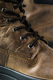 Fragment Leather Winter Boot. Fragment brown Leather Winter Boot, close up Stock Photo