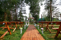 Fragment like view of nice chairs and arch ready for wedding ceremony. Wedding setup. fragment like view of nice chairs and arch ready for wedding ceremony Royalty Free Stock Photography