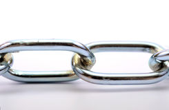 Fragment of links of a chain close up. Connection concept stock photography