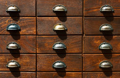 Fragment of locker with wooden catalogue boxes Ret Royalty Free Stock Images