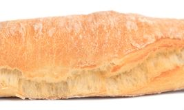 Fragment of long loaf. Royalty Free Stock Photo