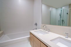 Fragment of luxury bathroom with bathtub and cabinets.  Stock Photos