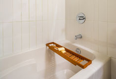 Fragment of a luxury bathroom. Fragment of luxury bathroom with wood bathroom caddy Stock Photos