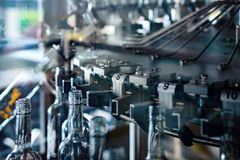 Fragment of a machine for washing glass bottles. Abstract industrial background Stock Photography