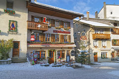 Fragment of the main street in the swiss village Gruyeres Royalty Free Stock Photo