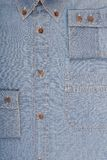 A fragment of male denim shirt. Royalty Free Stock Photo