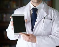 Fragment of a man in a doctor's coat Royalty Free Stock Images