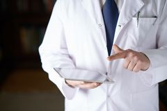 Fragment of a man in a doctor's coat Stock Photos