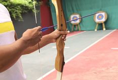 Fragment of a man holding a bow for shooting. stock image
