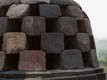 Fragment of masonry stupa Borobudur Temple on the Indonesian island of Java. Stock Photography