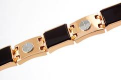 Fragment of a massive gold bracelet Royalty Free Stock Image