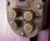 Fragment of a mechanical combination lock with rotary controls Stock Image