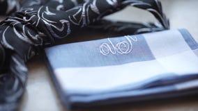 Fragment of a men`s shirt with a tie on floor. men`s tie and handkerchief. Men`s suits dress accessories pocket towel. Solid color scarf handkerchief HD Stock Photos