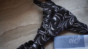 Fragment of a men`s shirt with a tie on floor. men`s tie and handkerchief. Men`s suits dress accessories pocket towel. Solid color scarf handkerchief HD Royalty Free Stock Image