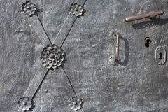 A fragment of metal doors. Royalty Free Stock Photo