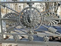 Fragment of a metal fence in the form of a lion stock photo
