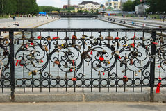 Fragment of metal fence with padlocks Stock Images